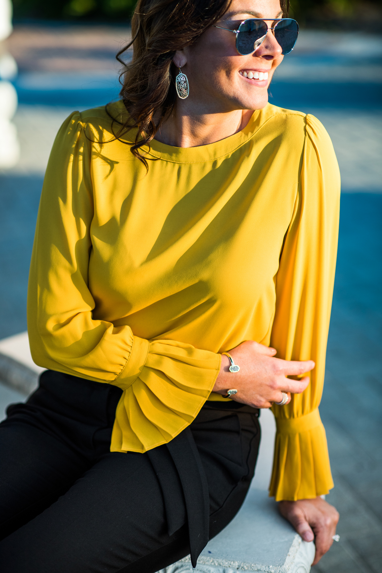 top sleeve detail, kendra Scott cuff, gold earrings, business casual