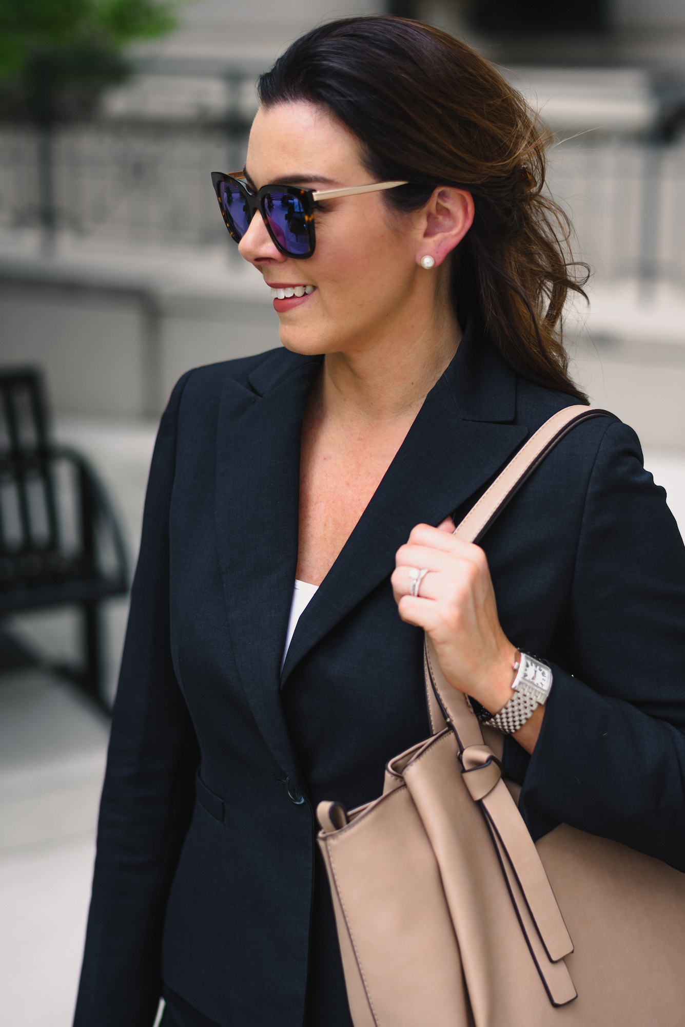 Navy skirt suit, business professional, pearl earrings